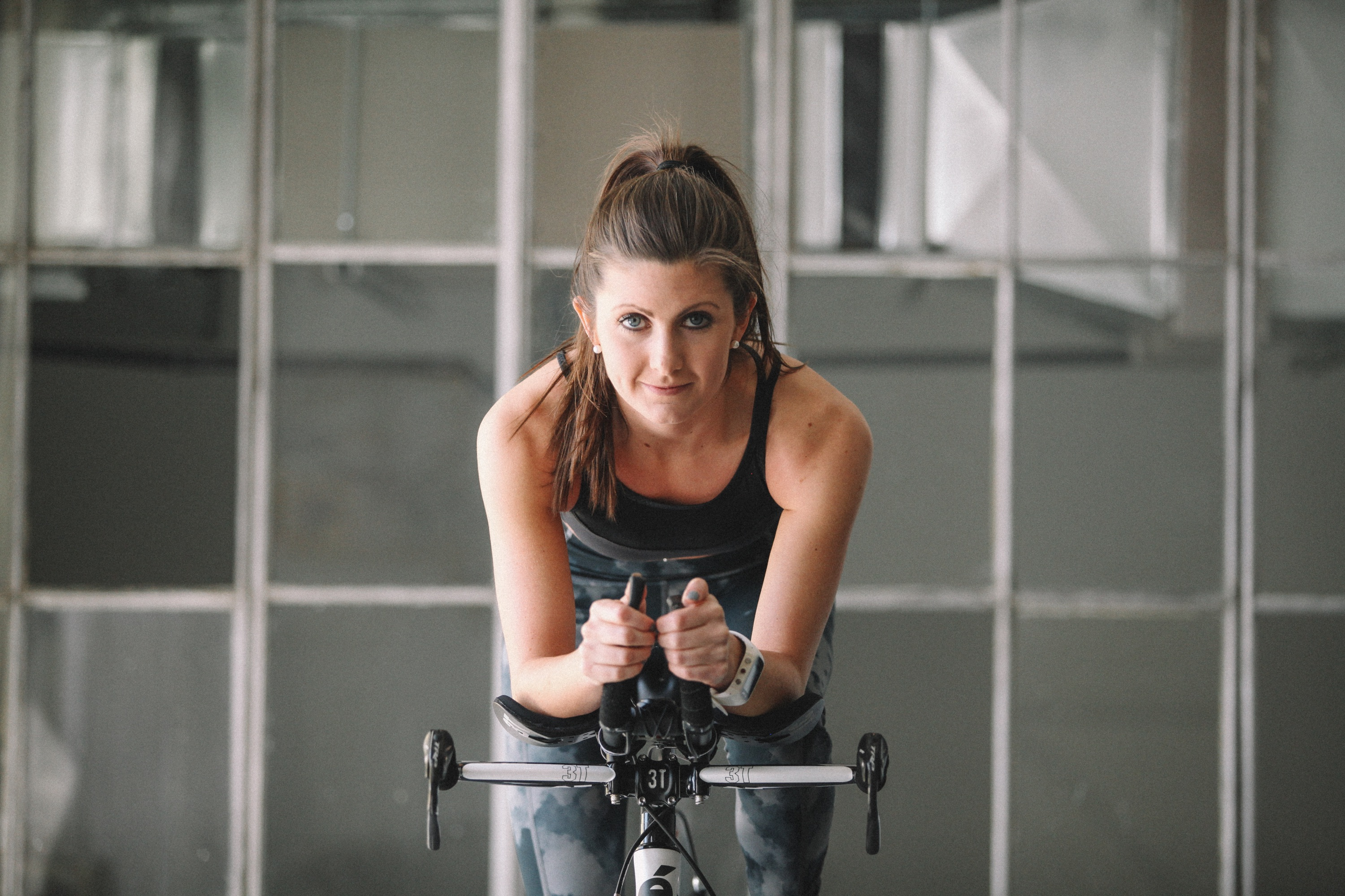 Ashley Niblett riding the bike during her fitness routine